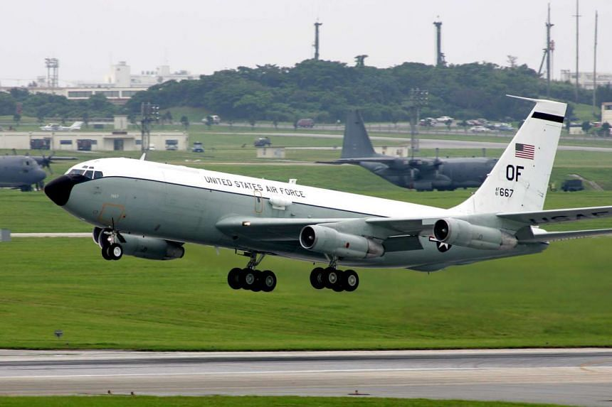 A US Air Force WC-135W Constant Phoenix taking off from Kadena Air Base, Okinawa.
