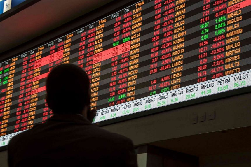 The electronic board displaying stock activity at the Brasil Bolsa Bacao (B3) stock exchange in Sao Paulo, Brazil, on Thursday, May 18.