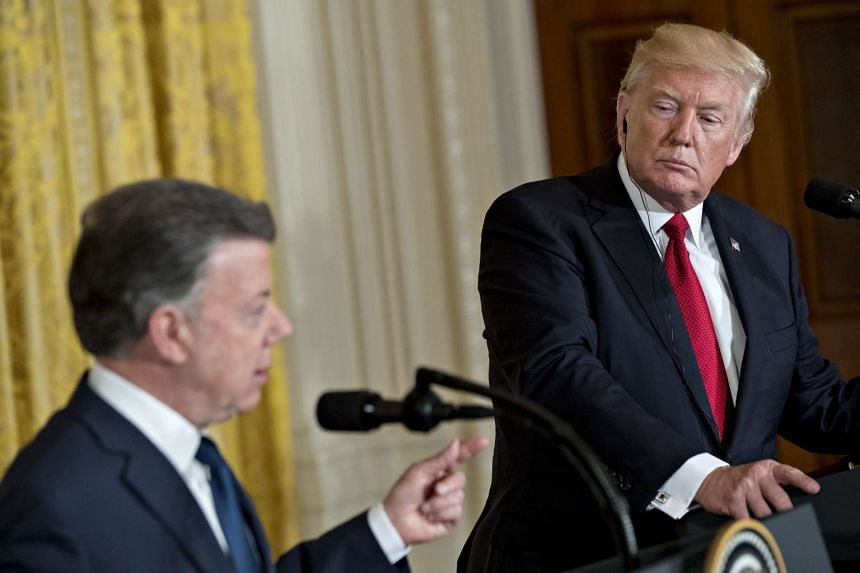 US President Donald Trump listens as Colombia's president Juan Manuel Santos speaks during a news conference in the East Room of the White House in Washington, D.C., US on May 18, 2017.