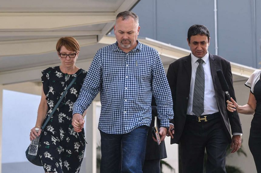 The sister and brother-in-law of Jason Peter Darragh, 44,  who has been remanded at Changi Prison's Complex Medical Centre, walk out of the State Courts with lawyer S.S. Dhillon (right), on Friday (May 19).