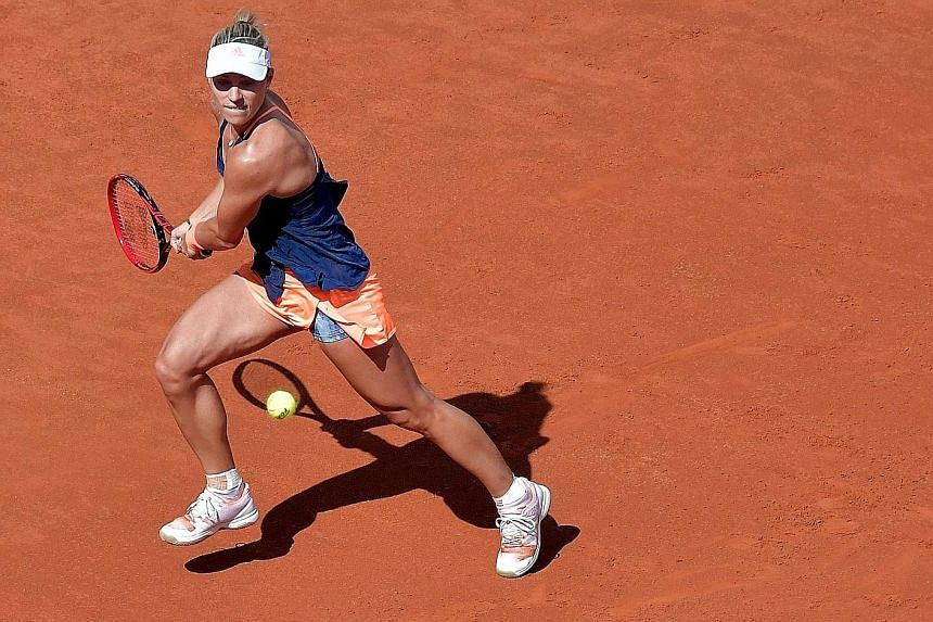 Angelique Kerber of Germany hitting a backhand against Estonia's Anett Kontaveit in the second round of the Italian Open on Wednesday. The world No. 68 Kontaveit won 6-4, 6-0.
