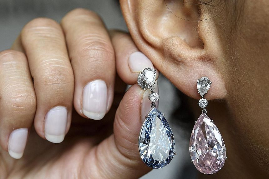 An unnamed Asia-based buyer netted both the earrings at an auction.