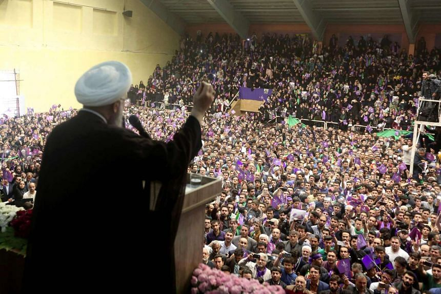 Iranian President and candidate in the upcoming presidential elections Hassan Rouhani speaking at a campaign rally in the north-western city of Ardabil on May 17.