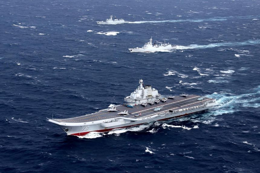 China's Liaoning aircraft carrier with accompanying fleet conducts a drill in an area of South China Sea in December 2016.