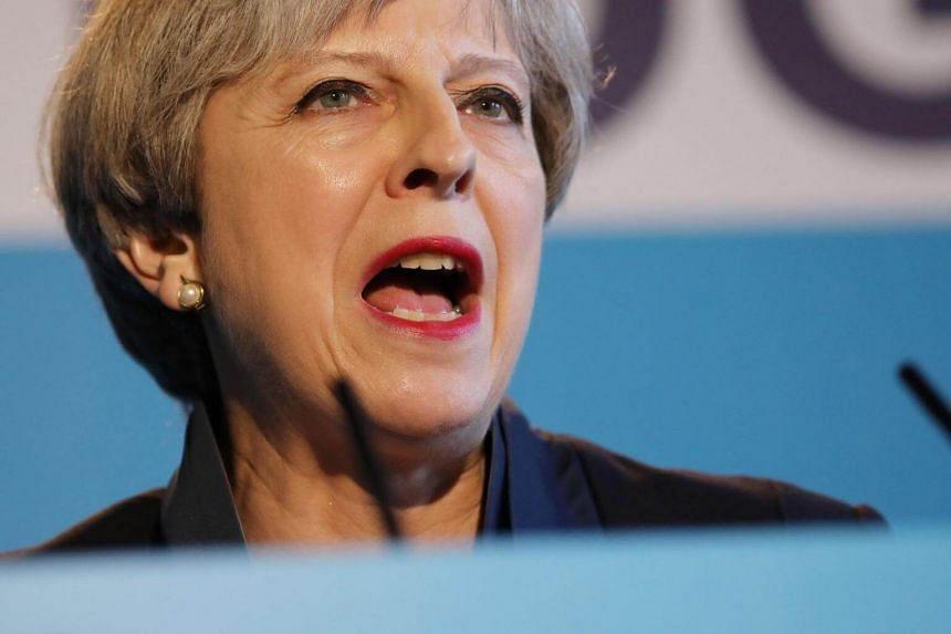 Britain's Prime Minister Theresa May speaks during an event to launch the Conservative Party general election manifesto in Halifax in northern England on May 18, 2017.