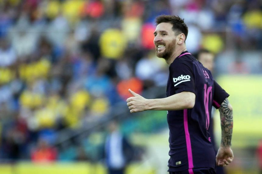 Barcelona's Argentinian forward Lionel Messi smiles during the Spanish league football match UD Las Palmas vs FC Barcelona at the Gran Canaria stadium in Las Palmas de Gran Canaria on May 14, 2017.