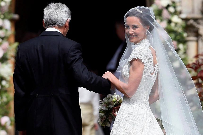 Pippa Middleton, the sister of Britain's Catherine, Duchess of Cambridge, arrives with her father Michael Middleton for her wedding to James Matthews at St Mark's Church in Englefield, west of London, on May 20, 2017.
