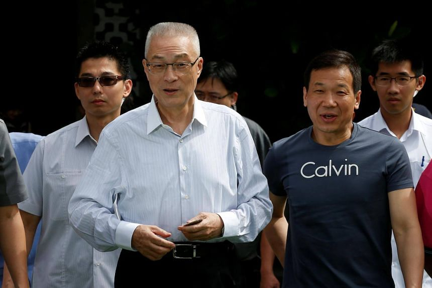 Wu Den-yih (centre), chairperson candidate of Taiwan's opposition Nationalist Kuomintang Party (KMT), arrives at a polling station to elect a new party chairman in Taipei, Taiwan, on May 20, 2017.