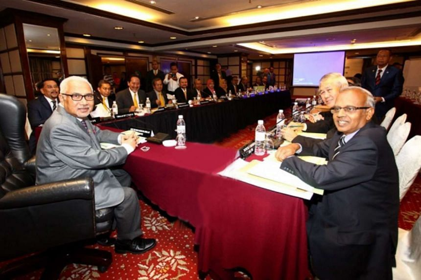 Election Commission chief Mohd Hashim Abdullah (left) said that if a political party finds that  voters have been shifted,  it should file objections.