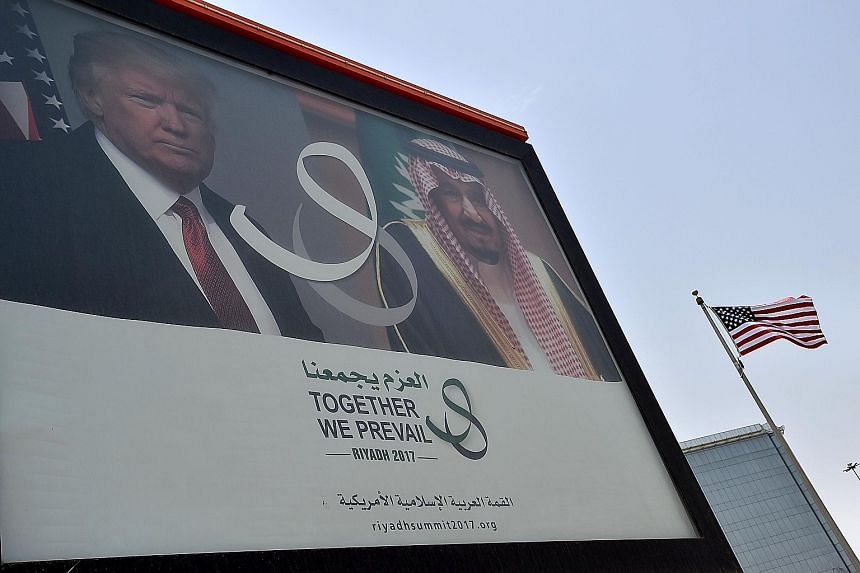 A giant billboard featuring US President Donald Trump and Saudi King Salman bin Abdulaziz al-Saud on display in Riyadh, ahead of the US leader's first trip to the region. It is seen as a major test for a president beleaguered at home and who is new t