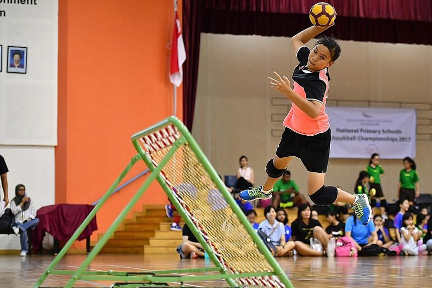 Greendale Primary School team captain Rachel Ong leaping in an attempt to score a goal. Her team beat Junyuan Primary School 11-8 on their opponents' turf to emerge champions in the Senior Division final of the SPH Foundation National Primary Schools