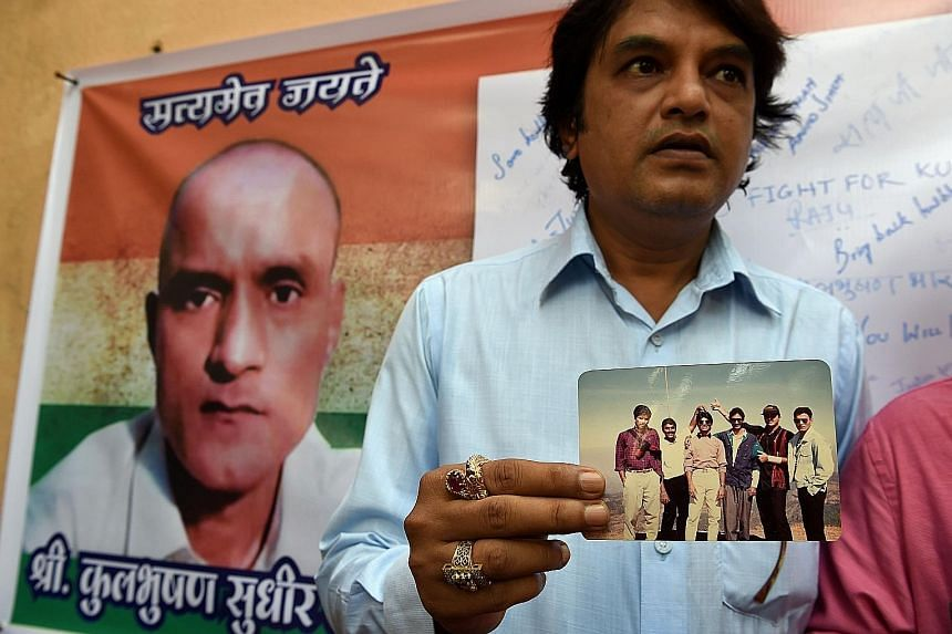 Former Indian naval officer Kulbhushan Sudhir Jadhav, whose image is on a banner here, has been accused by the Pakistani government of fomenting terrorist activities in the restive south-west province of Baluchistan, and sentenced to death. A friend