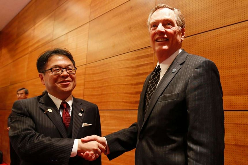 US trade representative Robert Lighthize (R) and Japan's trade minister Hiroshige Seko shake hands during the Asia-Pacifics Economic Cooperation (Apec) 23rd Ministers responsible for Trade Meeting at the National Convention Center in Hanoi on May 20,