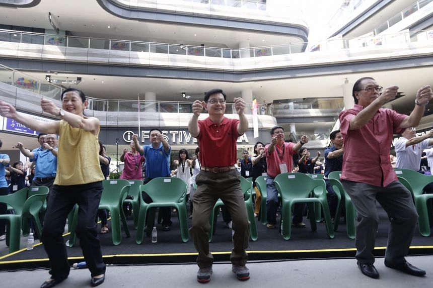 Mr Heng Swee Keat taking part in a mass exercise during the National Neuroscience Institute Brain Awareness Carnival at Our Tampines Hub on May 20.