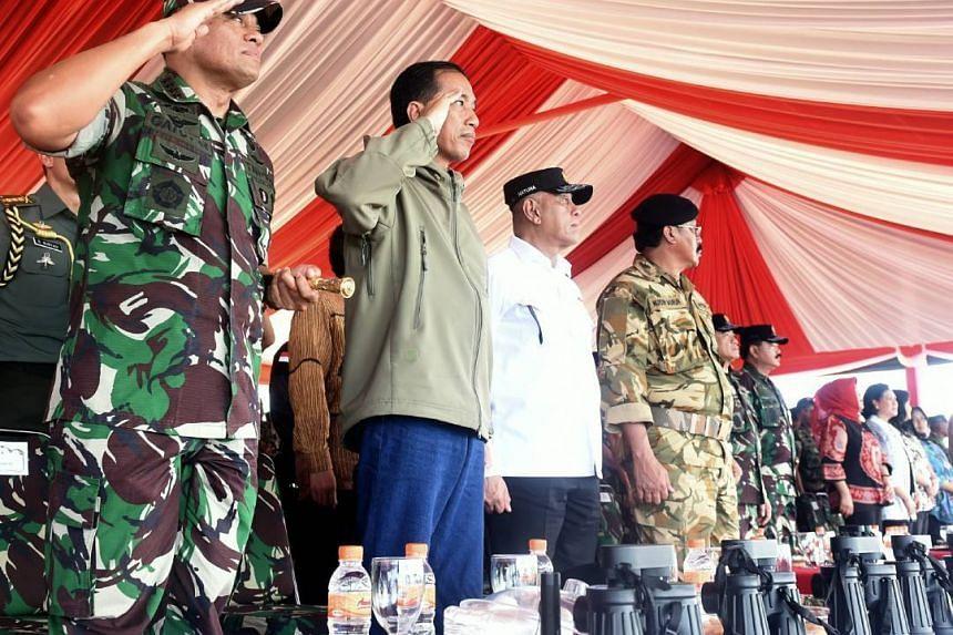 President Joko  Widodo observing a massive military drill around the resource-rich Natuna Islands.