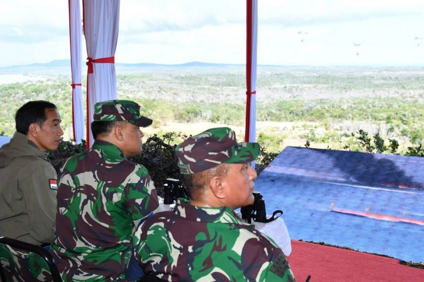 The drill included a war simulation involving Indonesian-owned Russian-made Sukhoi and American-made F-16 fighter jets, tanks and warships, as well as parachute landings.