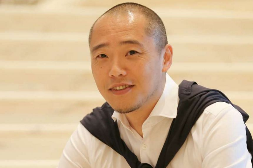 Tokyo-based Ryoichi Niwata (above) of Bond Design Studio was behind the Tower Wing facelift.