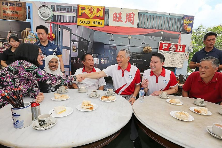 ABOVE: PM Lee Hsien Loong and Sengkang West MP Lam Pin Min (seated, second from right) with residents and grassroots leaders at the event yesterday. LEFT: The winning design for the facade of the new facility.