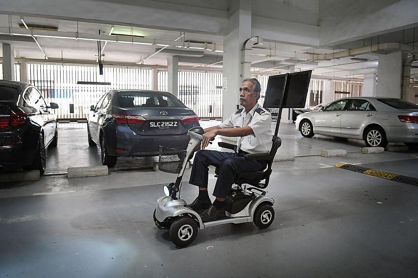 Security officer Mohd Azan Abd Khair is able to double the number of rounds by using an electric scooter to patrol the Watermark apartment complex at Rodyk Street in Robertson Quay.