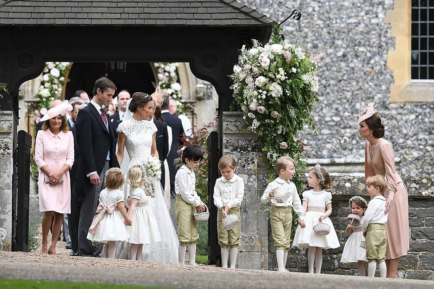The Duchess of Cambridge, Kate (right), with her children George and Charlotte, after the wedding of her sister Pippa Middleton to Mr James Matthews at St Mark's Church in Englefield, west of London, yesterday. The duchess' mother Carole Middleton is