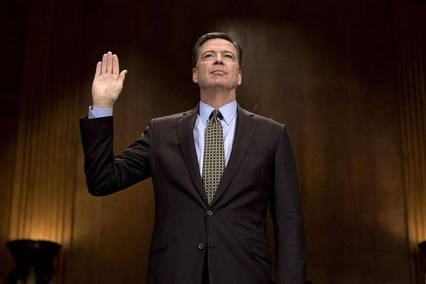 Then-FBI Director James Comey being sworn in prior to testifying before the Senate Judiciary Committee on May 3, 2017.