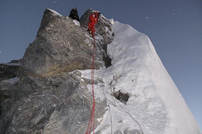 Members of the Natas Singapore Women's Everest Team making their way down the infamous Hillary Step in 2009.