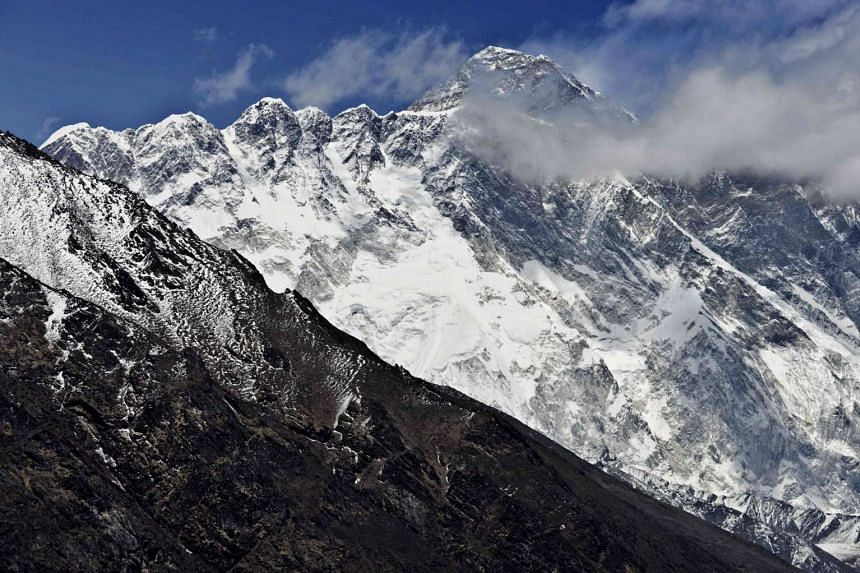 Mount Everest (Background) and the Nupse-Lohtse massif (foreground) in a photo from April 2015.
