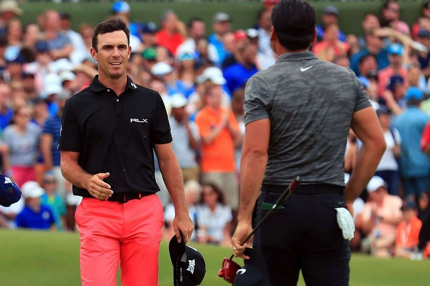 Billy Horschel (left) goes to shake hands with Australia's Jason Day after beating Day in the play-off.