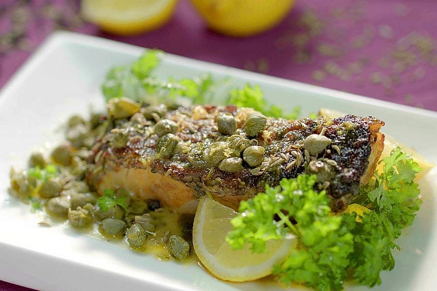 Chef Sherson Lian injects East-meets-West twists into his dishes, such as curry powder in the classic Western dish of baked cod with caper butter (above).