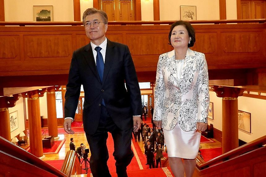 Mr Moon Jae In and his wife, Ms Kim Jung Sook, arriving at the presidential Blue House in Seoul on May 10. Her decision to eschew the traditional hanbok for his inauguration ceremony has been cited as a signal that she might well stray from the more