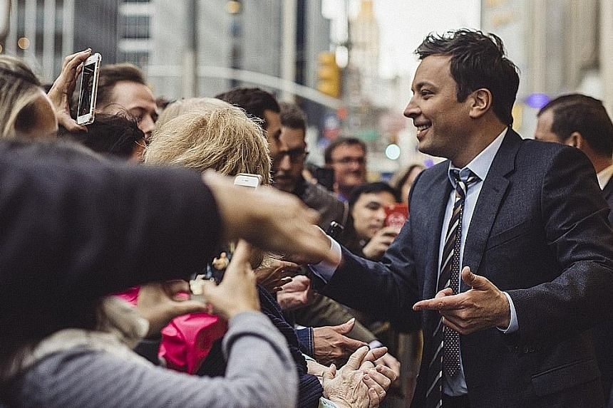 The Tonight Show host Jimmy Fallon greeting fans outside Rockefeller Center in New York City earlier this month.