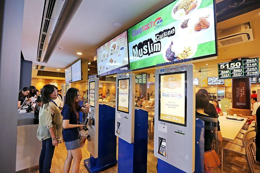 The FoodTastic coffee shop in Choa Chu Kang Avenue 1 has features such as digital order kiosks, a tray-return robot and a food-waste composter machine.