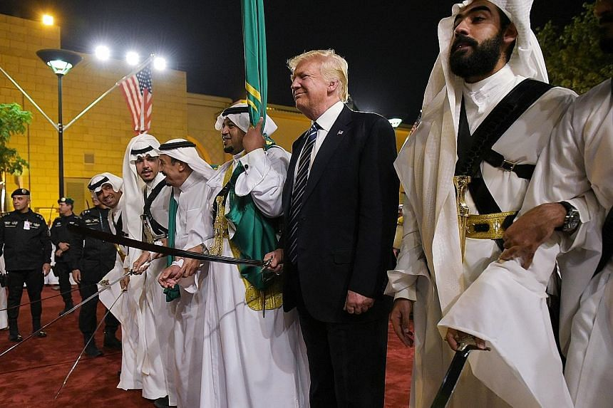 US President Donald Trump joining dancers performing the Ardha, a traditional sword dance, as he arrived for a banquet at the the Murabba Palace in Riyadh last Saturday.