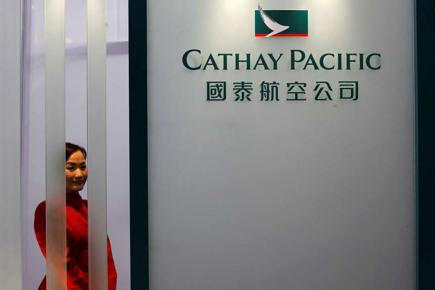 A Cathay Pacific Airways flight attendant poses at the airline's booth during the Asian Aerospace Show in Hong Kong, on March 8, 2011.