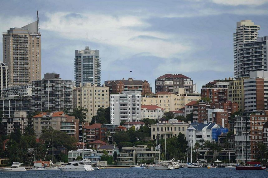 Residential properties are seen from Sydney Harbour. Home prices in Sydney and Melbourne have surged in the wake of unprecedented interest-rate cuts by the Reserve Bank of Australia.
