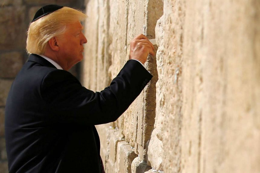 President of the United States Donald Trump leaves a note at the Western Wall in Jerusalem on Monday (May 22). PHOTO: REUTERS