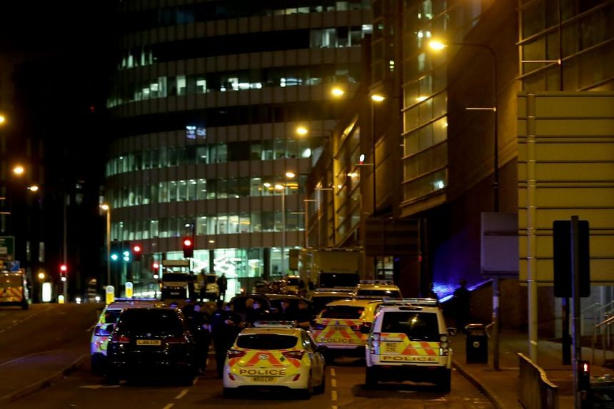 Emergency vehicles are seen outside the Manchester Arena following the explosion, in Manchester, Britain, on May 23, 2017.