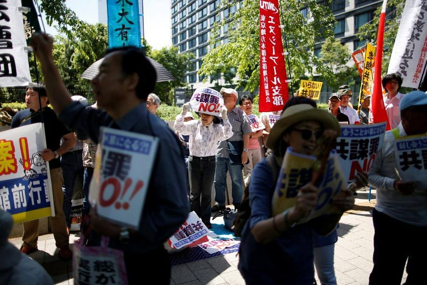 Protesters shout slogans as they protest against an anti-conspiracy bill outside the parliament building in Tokyo, Japan on May 23, 2017.
