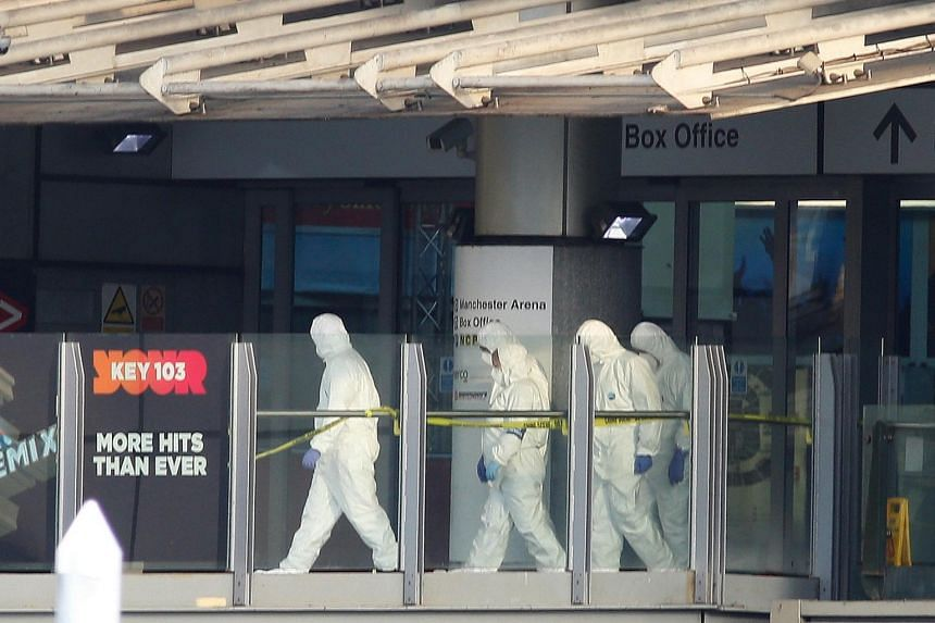 Forensic police search the Manchester Arena in Manchester, Britain on May 23, 2017.