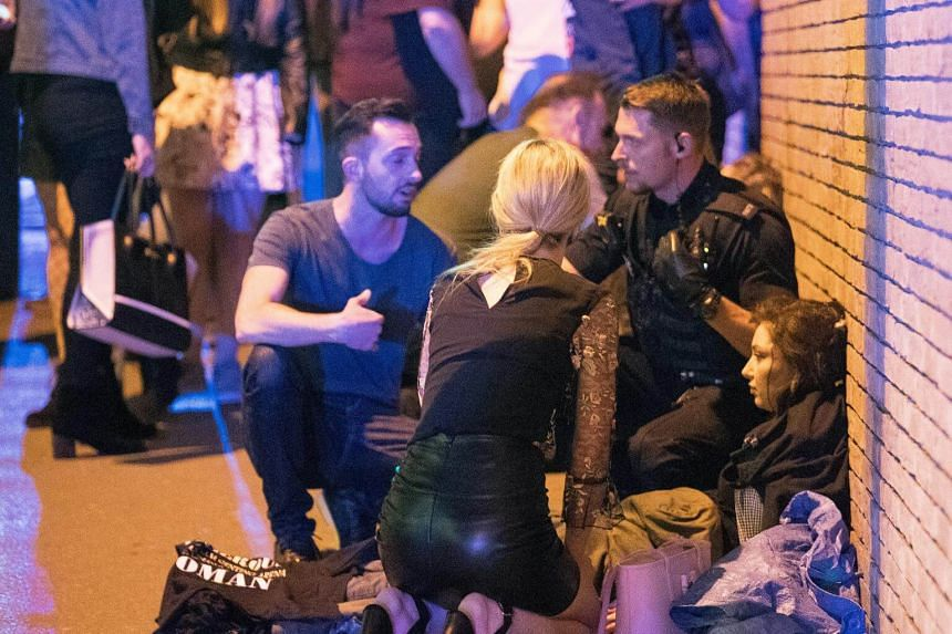 Wounded people on the Hunts Bank outside Victoria Station and the stairs leading to the Manchester Arena on May 22, 2017.