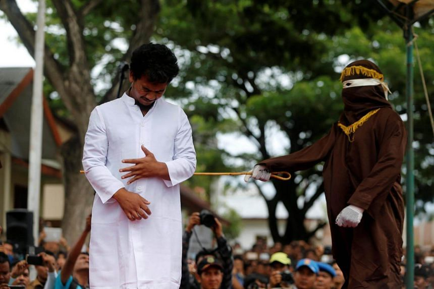 An Indonesian man is publicly caned for having gay sex in Banda Aceh, Aceh province, Indonesia on May 23, 2017.