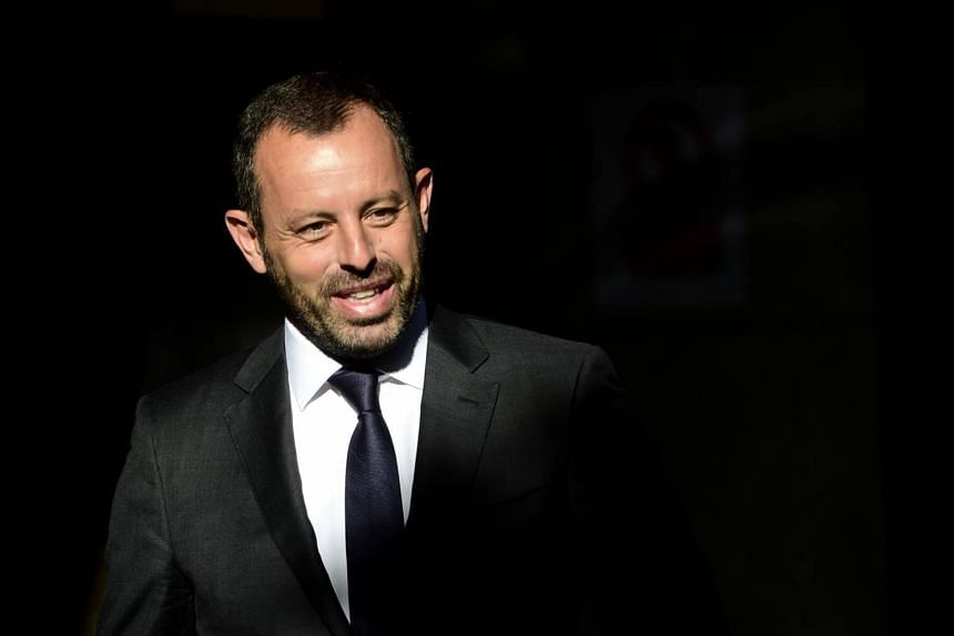 Spanish police have held ex-Barcelona president Sandro Rosell and his wife in a money-laundering probe.