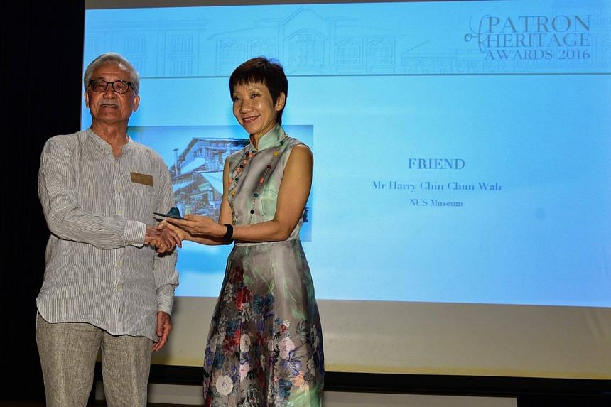Mr Harry Chin receiving the award from Minister for Culture, Community and Youth & Leader of the House Grace Fu at the Asia Civilisations Museum.
