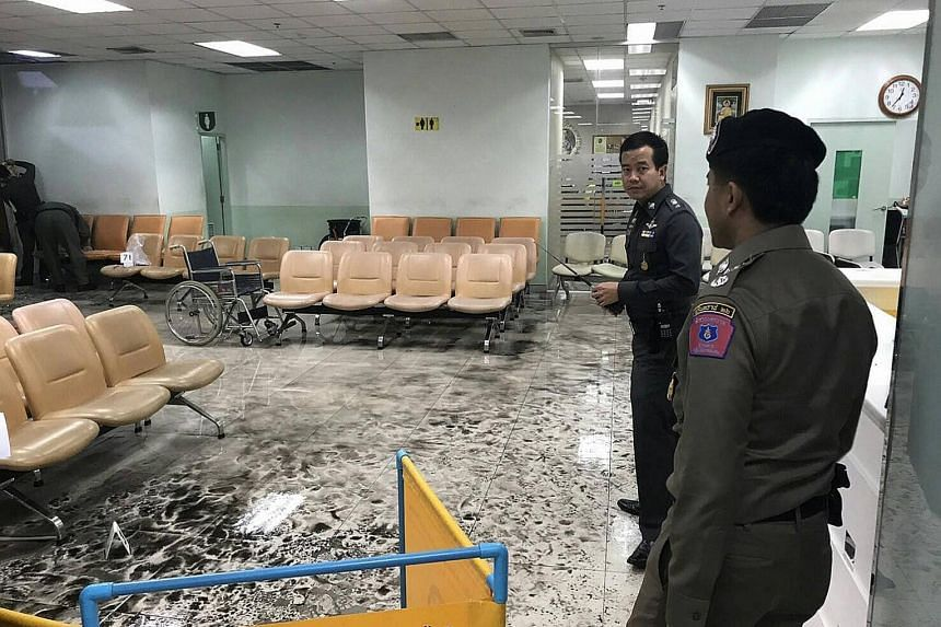 Thai military personnel at the scene of the blast at Phramongkutklao Hospital. Army chief Chalermchai Sitthisart says the explosive device was intended to take lives as it was loaded with lots of nails.