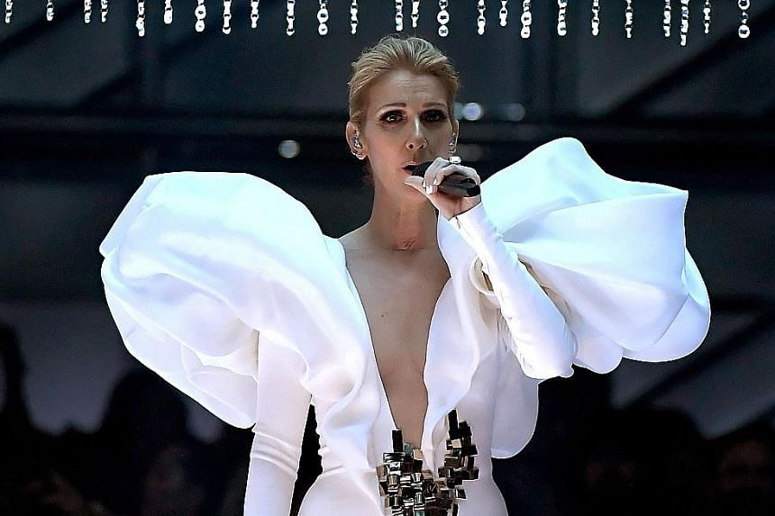 Miley Cyrus returned to her country roots with a pared-down performance of Malibu, while Celine Dion (above) struggled to hold back her tears when she performed My Heart Will Go On.