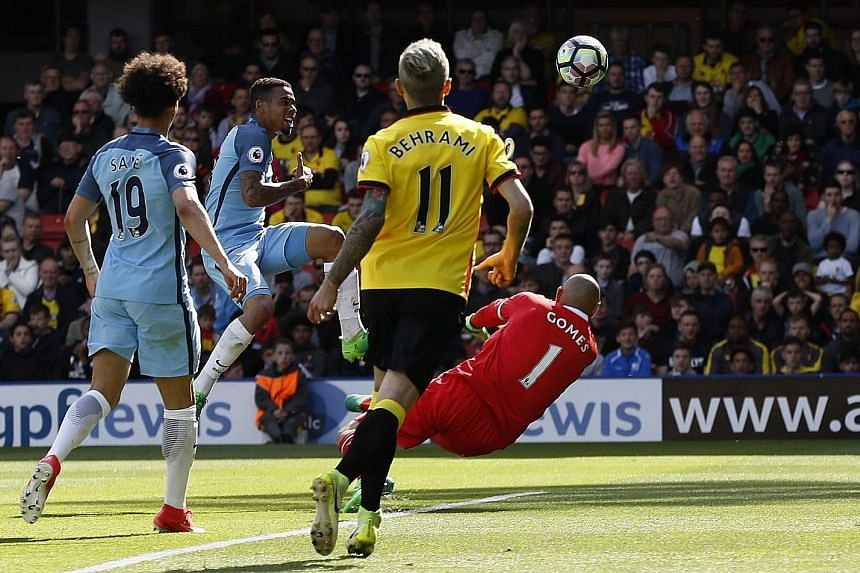 Gabriel Jesus lifting the ball over Watford goalkeeper Heurelho Gomes for Manchester City's fifth in their 5-0 whipping of Watford, sealing third spot in the league in Pep Guardiola's first season in England.