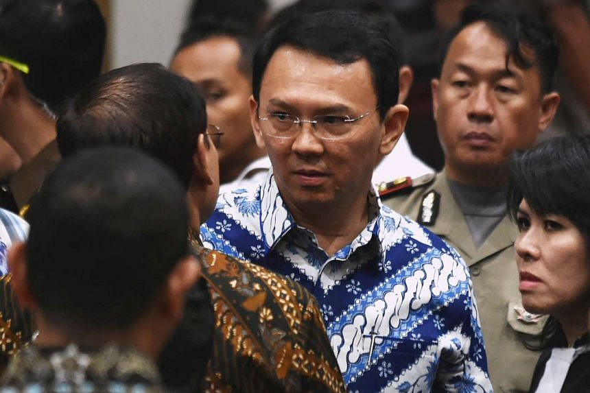 Jakarta governor Basuki Tjahaja Purnama, popularly known as Ahok, speaking to his lawyers after a guilty verdict was handed down by the court, in Jakarta on May 9, 2017.