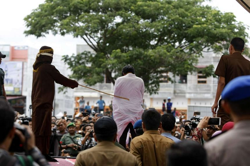 A man being whipped in public for being in a same-sex relationship, in Banda Aceh on May 23, 2017.