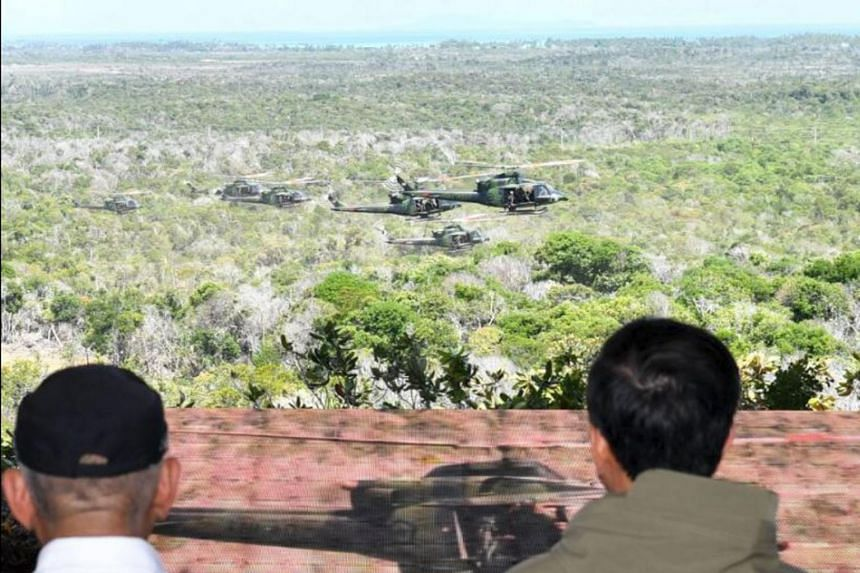 Indonesian President Joko Widodo observes a massive military drill around the resource-rich Natuna Islands, an area where Indonesian maritime authorities have had a number of run-ins with Chinese vessels on May 19, 2017.