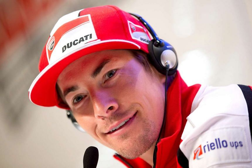 Nicky Hayden smiles during a news conference in Madonna di Campiglio in 2013.